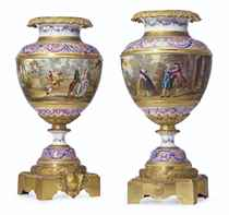 A PAIR OF ORMOLU-MOUNTED SEVRES STYLE PALE-PINK GROUND PORCE