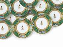 TWELVE COPELAND PORCELAIN MONOGRAMMED AND CRESTED GREEN-GROUND PLATES