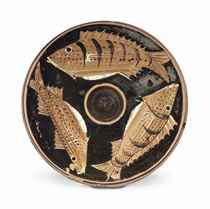 AN APULIAN RED-FIGURED FISH-PLATE