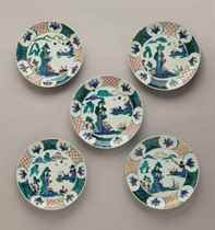 A set of five circular porcelain dishes