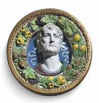 A POLYCHROME-GLAZED TERRACOTTA BUST OF A LAUREATE IN A FRAME