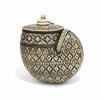AN IVORY AND MOTHER-OF-PEARL INLAID POWDER FLASK
