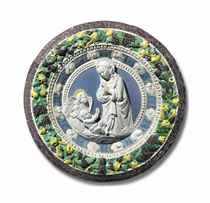 A GLAZED TERRACOTTA ROUNDEL DEPICTING THE VIRGIN AND CHILD W