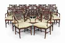 A SET OF EIGHTEEN PARCEL-GILT AND MAHOGANY DINING-CHAIRS