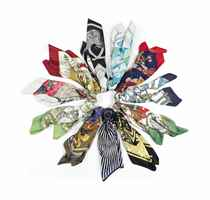 A COLLECTION OF ELEVEN SCARVES