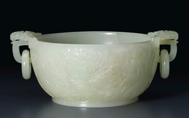 A white jade marriage bowl, Qianlong Period (1736-1795). 7 78 in (20 cm) wide across handles.  This work was offered in the Mandarin & Menagerie The Sowell Collection, Part II sale on 16 September 2015 in New York