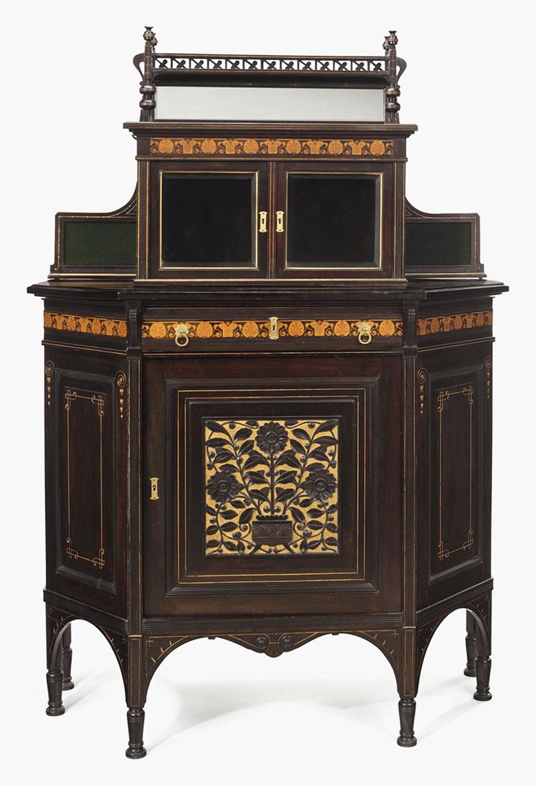 An Aesthetic Movement inlaid, parcel-gilt and part-ebonized cherrywood and maple cabinet, attributed to Herter Brothers (1864-1906), New York, circa 1880. This lot was offered in American Furniture, Outsider Art and Silver on 20 September 2016 at Christie's in New York and sold for $25,000