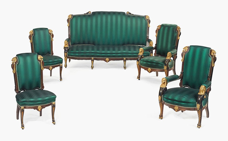 An Egyptian Revival gilt-metal mounted, parcel-gilt, ebonized and inlaid rosewood parlour suite, attributed to Pottier and Stymus (1859-1910), New York, circa 1870. This lot was offered in American Furniture, Outsider Art and Silver on 20 September 2016 at Christie's in New York and sold for $30,000