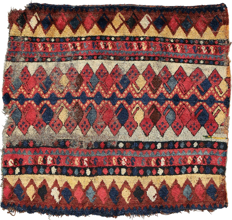 A central Asian trapping. Possibly Kyrgyz, early 19th century. 2 ft 4 in x 2ft 7 in (71 cm x 79 cm). This piece was offered in Oriental Rugs and Carpets on 19 April 2016 at Christie's in London