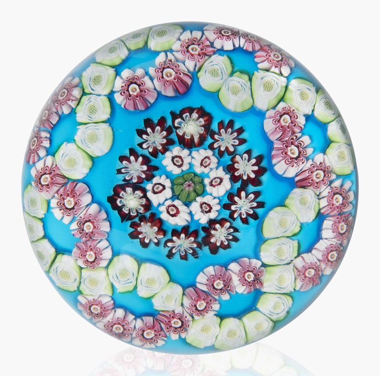 A Clichy patterned millefiori colour-ground weight. Mid-19th century. This lot was offered in Dress Your Desk Paperweights from the Neustadter Collection, 8-20 April 2016, Online