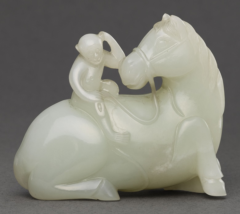 A white jade 'horse and monkey' carving, 18th century. This work was offered in Inspired Themes a Fine Selection of Chinese Works of Art on 10 May 2016 at Christie's in London and sold for £50,000