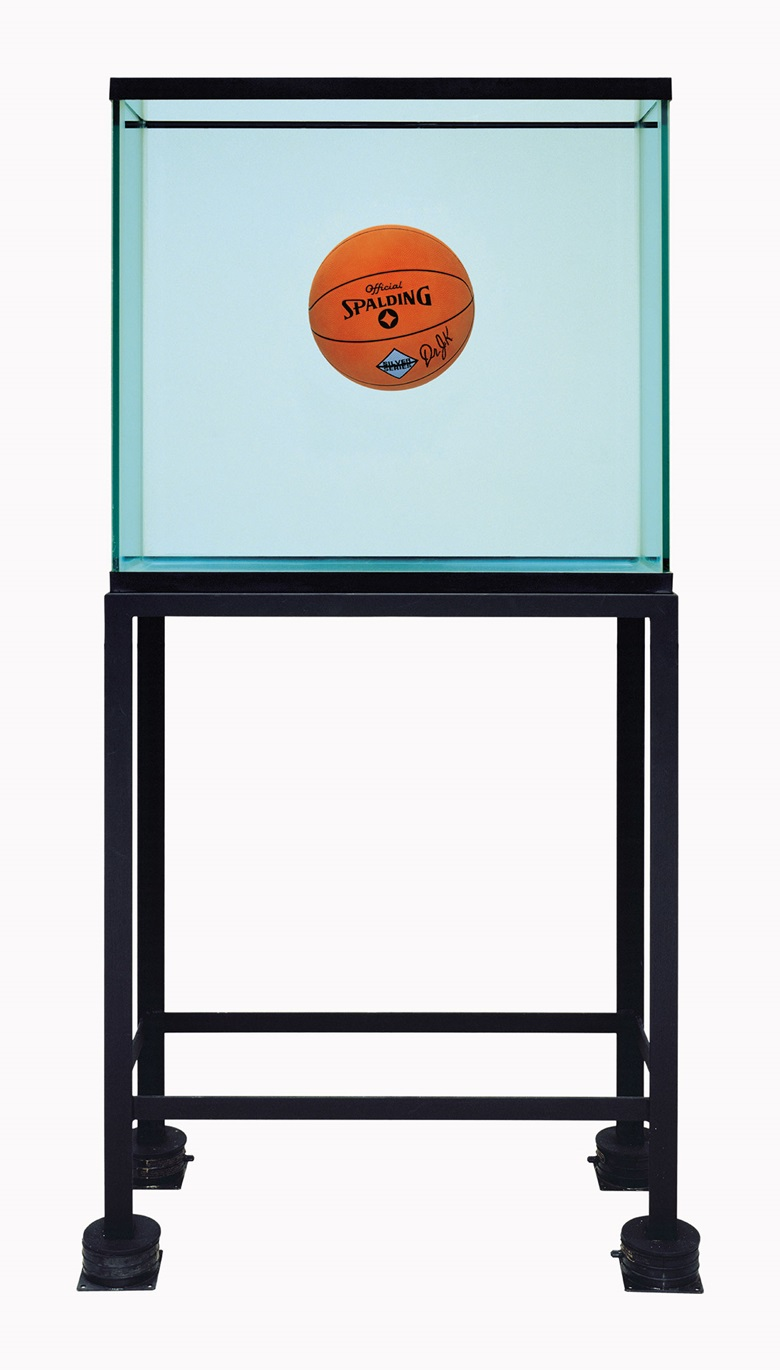 Jeff Koons (b. 1955), One Ball Total Equilibrium Tank (Spalding Dr. J Silver Series), 1985. Glass, steel, sodium chloride reagent, distilled water and basketball. 64¾ x 32¾ x 15½ in (164.6 x 83.1 x 39.3 cm). This work is number one from an edition of two. This work was offered in Bound to Fail on 8 May at Christie's in New York and sold for $15,285,000