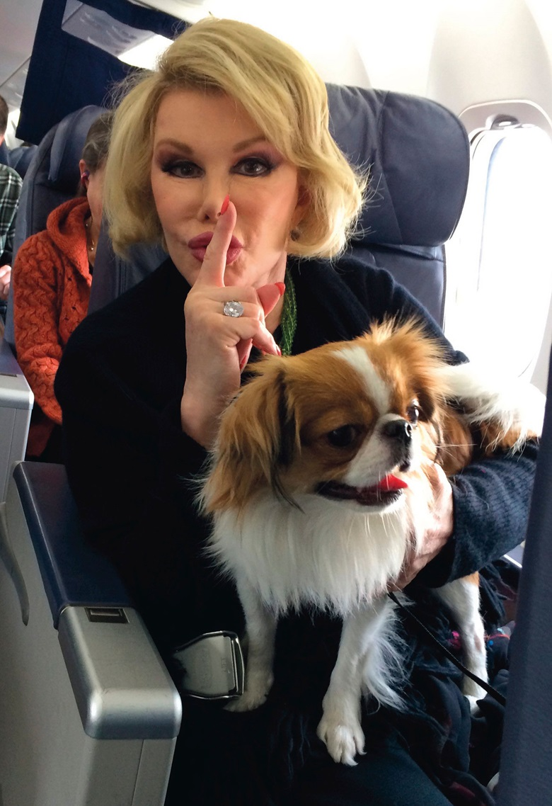 Joan Rivers with Teegan, the Japanese Chin who accompanied her everywhere