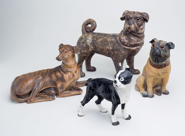 Four English stoneware figures of dogs. Estimate $1,000-1,500. This lot will be offered in The Private Collection of Joan Rivers on 22 June at Christie's in New York