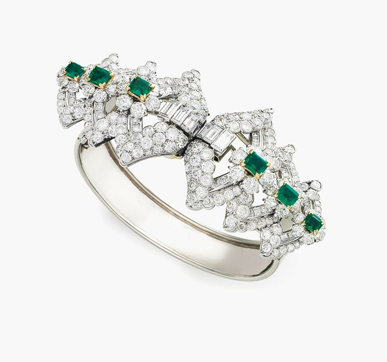 An Art Deco diamond and emerald bangle bracelet, by Cartier. Estimate $20,000–30,000. This piece is offered in Magnificent Jewels & the Jubilee Ruby on 20 April at Christie's New York