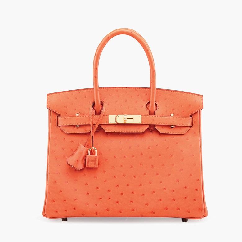 eab0290b7462 A tangerine ostrich Birkin 30 bag with gold hardware. Hermès