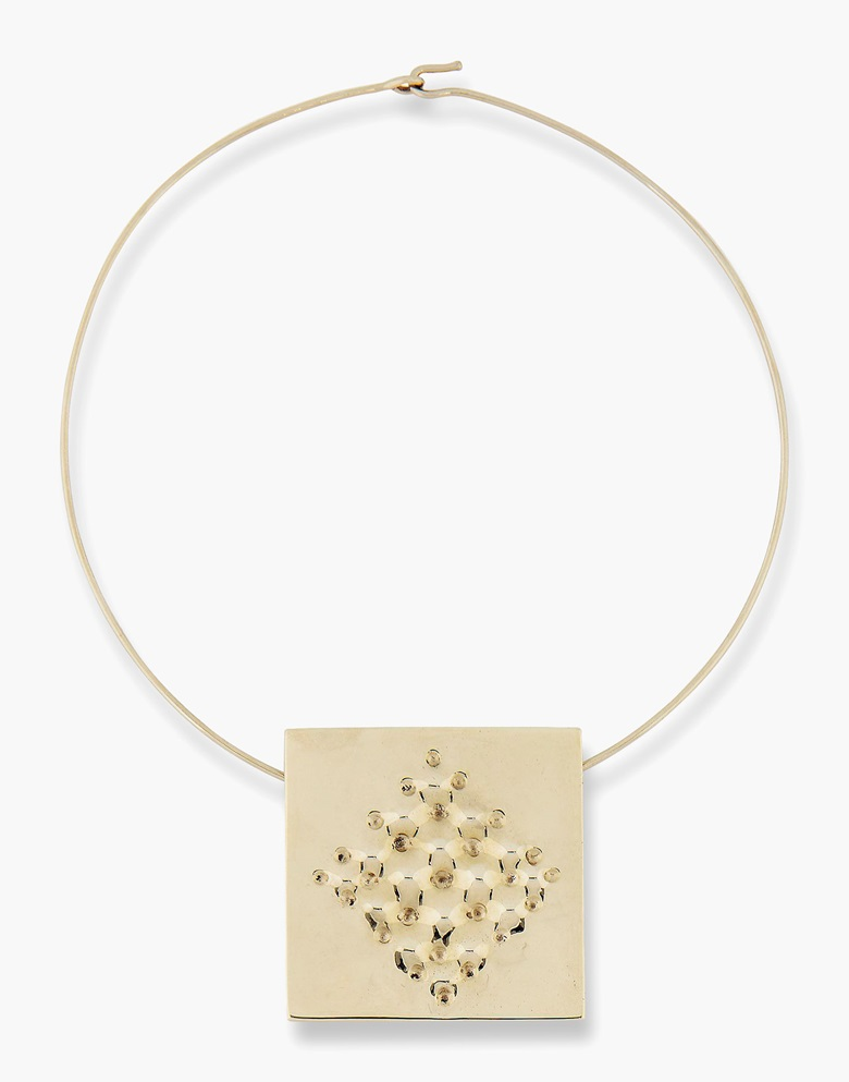 Enrico Castellani (b. 1930), Superficie, 2012. White gold necklace. Pendant 2½  x 2 ½ in. (6.2 x 6.2 cm.) Necklace diameter 6 in. (15.3 cm.). Estimate $30,000-50,000. This work is offered in Art as Jewellery, 6-18 May, Online