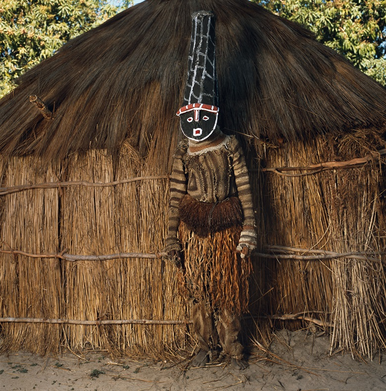 Kambweti (Walks with Sticks) Likishi Masquerade , Zambia (2007). © Phyllis Galembo, courtesy Steven Kasher Gallery.