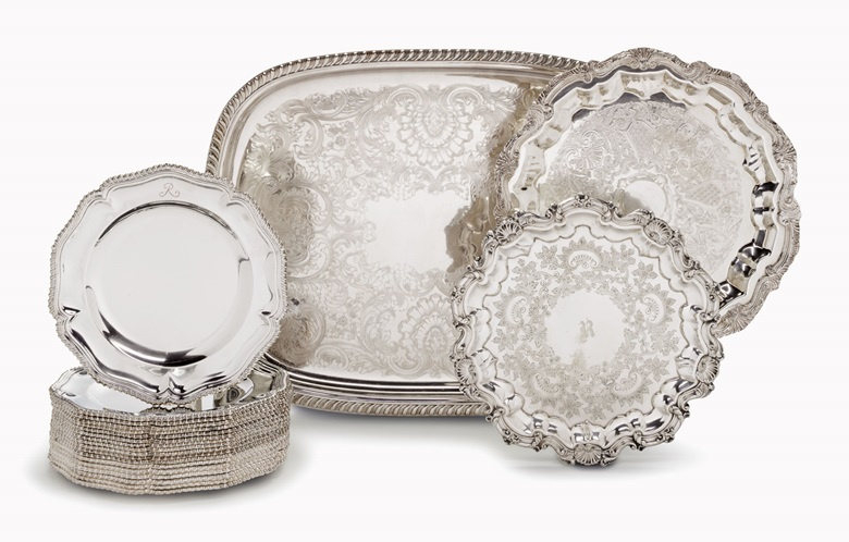 Three silver plate serving trays and an assembled set of 18 george iv