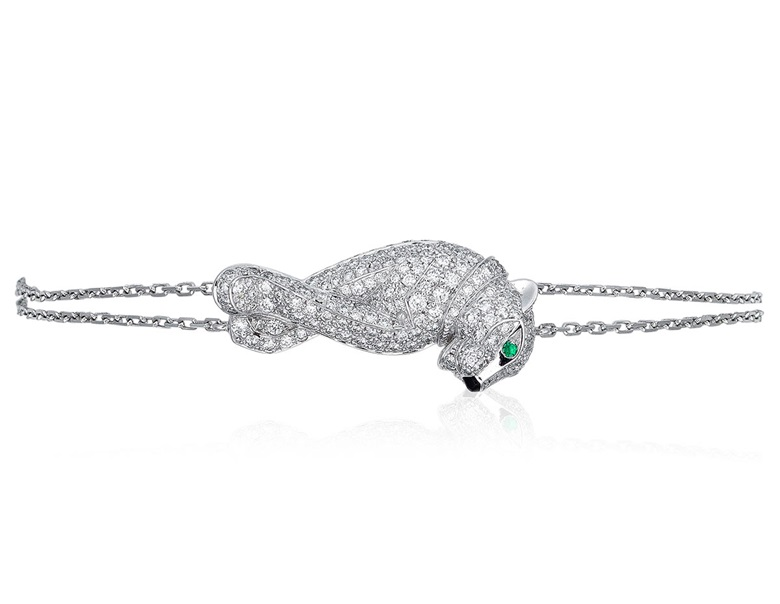 Cartier diamond and emerald Panthère bracelet. Designed as a diamond set panther with emerald eyes and black lacquer nose on white gold chain. Estimate $15,000–25,000 HKD