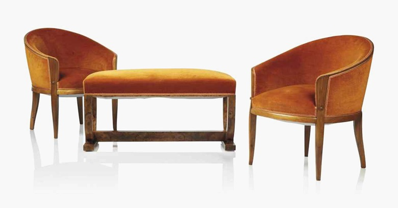 A pair of Jules Leleu (1883-1961) walnut armchairs and associated burr walnut bench, circa 1950. The chairs stamped 'J Leleu'. Each upholstered with orange velvet and sprung seats. The chairs 30 ¾ in. (78 cm.) high; 25 ½ in. (65 cm.) wide; 26 ¾ in. (68 cm.) deep; the bench 20 in. (51 cm.) high; 39 in. (99 cm.) wide; 16 ½ in. (42 cm.) deep. Estimate