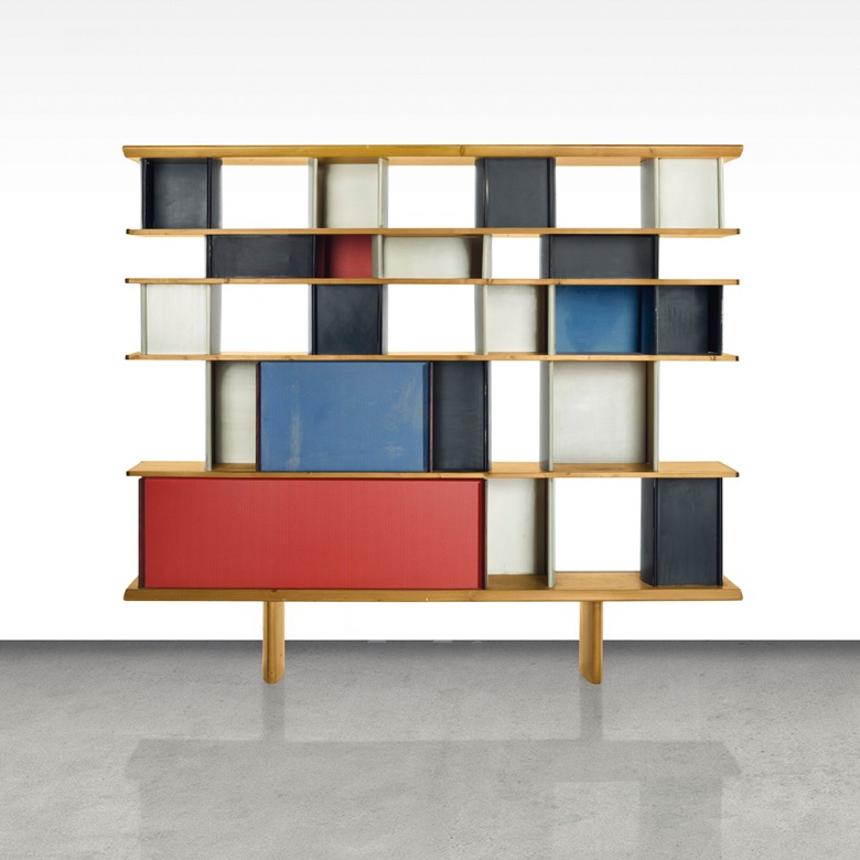 Charlotte Perriand (1903-1999), a Mexique bibliothèque, designed circa 1953. Designed for the Maison du Méxique, Cité Internationale Universitaire, Paris. Executed by Ateliers Jean Prouvé, pine, mahogany, enamelled steel, aluminium, 63 in (160 cm) high, 72 in (183 cm) wide, 12⅞ in (32.7 cm) deep. This work was offered in the Design sale on 8 June 2016 at