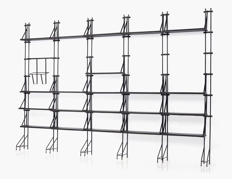 Jacques Adnet (1900-1984), An adjustable shelving system, 1950s. Leather, painter metal. 87 ¾ in. (223 cm.) high, 126 in. (320 cm.) wide, 9 ¾ in. (24.7 cm.) deep. Estimate $20,000-30,000. This work is offered in the Design sale on 8 June at Christie's New York