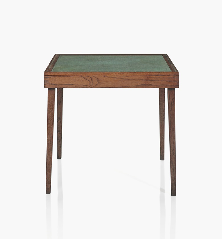 Jean-Michel Frank (1895-1941), A Games Table, 1938. Oak with wool surface. 28 ½ in. (72.5 cm.) high, 30 ¾ in. (78 cm.) square. Estimate $25,000-35,000. This work is offered in the Design sale on 8 June at Christie's New York
