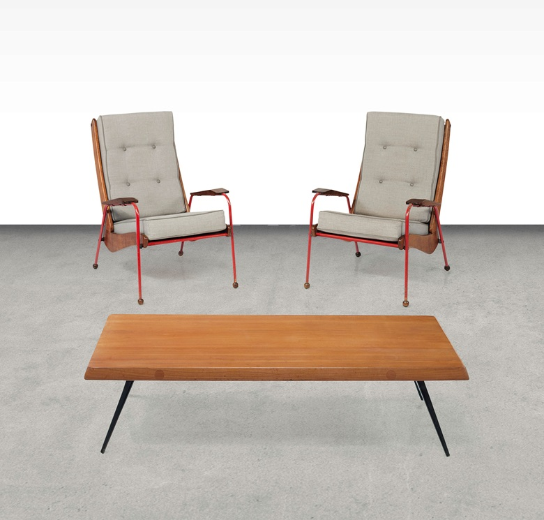Jean Prouvé (1901-1984), a pair of Visiteur armchairs, circa 1950. Produced by Ateliers Jean Prouvé, oak, plywood, enamelled steel tube, aluminium, upholstered cushions. Each 37½ in (95.2 cm) high. This work was offered in the Design sale on 8 June 2016 at Christie's New York and sold for $93,750