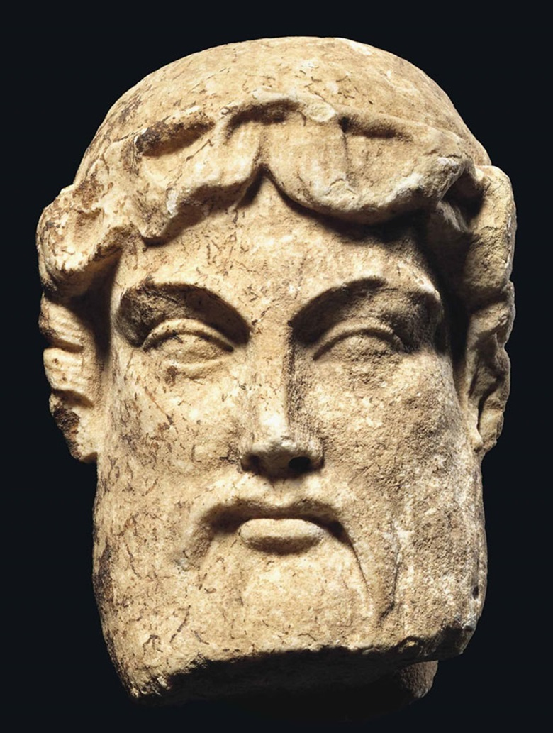 A Roman marble archaistic head of Hermes, circa 1st century BC. 5¼ in (13.5 cm) high. This lot was offered in Antiquities on 6 July 2016 at Christie's in London, King Street