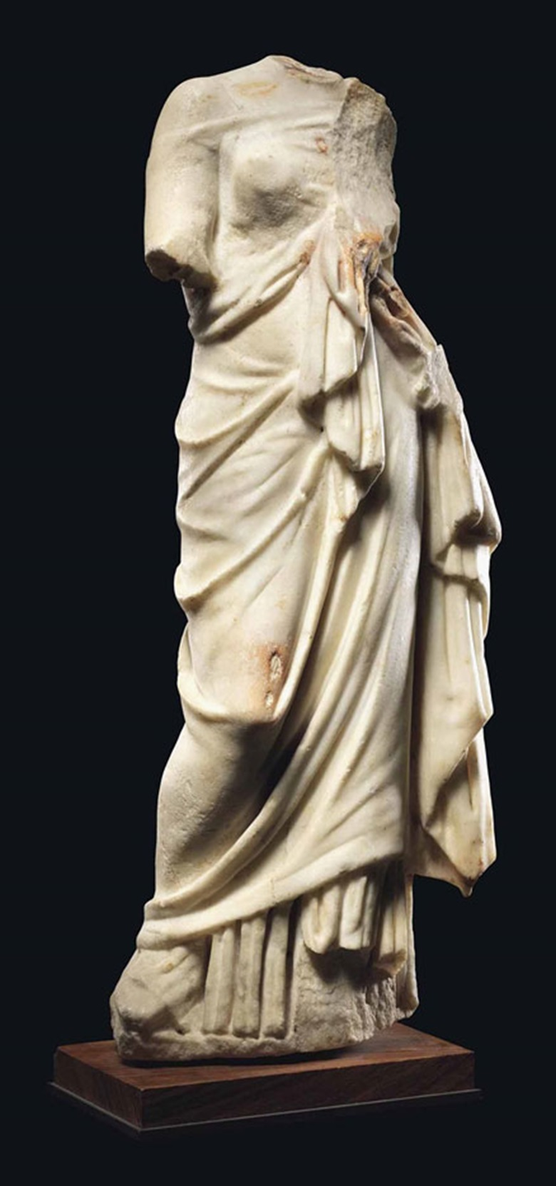 A Roman marble goddess, circa 2nd-3rd century AD. 22 in (56 cm) high. This lot was offered in Antiquities on 6 July 2016 at Christie's in London, King Street and sold for £18,750