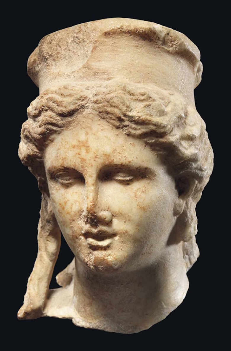 A Roman marble head of Cybele, circa 1st century BC-1st century AD. 5⅛ in (13 cm) high. This lot was offered in Antiquities on 6 July 2016 at Christie's in London, King Street and sold for £15,000