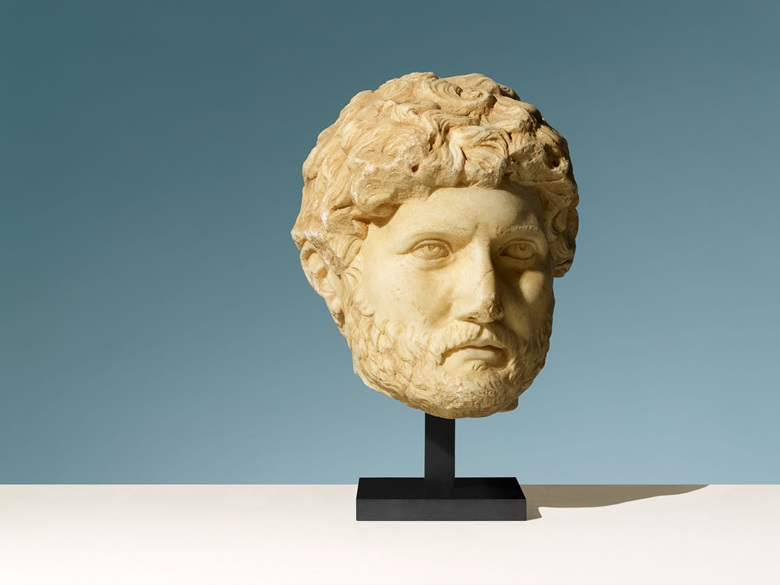A monumental Roman marble head of the Emperor Hadrian. Late Hadrianic-early Antonine period, circa 120-193 AD. 13 in (33 cm) high. This lot was offered in Antiquities on 6 July 2016 at Christie's in London, King Street and sold for £842,500