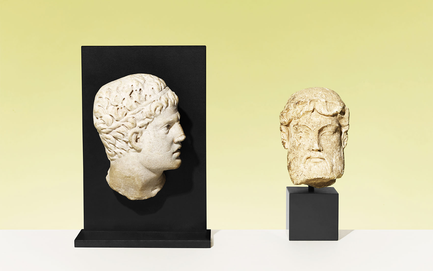 A Roman marble relief head of Meleager, circa 2nd century AD. 6¼ in (16 cm) high. Sold for £8,125. A Roman marble archaistic head of Hermes, circa 1st century BC. 5¼ in (13.5