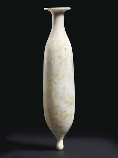A Roman opaque white glass alabastron. Circa 1st century AD 5¾ in (14.6 cm) high. Estimate £3,000-4,000. This lot is offered in Antiquities on 6 July 2016 at Christie's in London, King Street