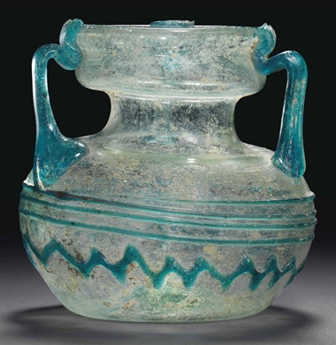 A Roman pale-green glass jar. Circa 4th century AD, 3⅜ in (8.5 cm) high. Estimate £2,500-3,500. This lot is offered in Antiquities on 6 July 2016 at Christie's in London, King Street