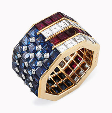 A diamond, sapphire and ruby ring, by Bulgari. Of octagonal shape, set with square-cut sapphires, rubies and diamonds in an American flag motif, ring size 5½, with French assay marks for platinum and 18k gold. Estimate $5,000-8,000. This lot will be offered in The Private Collection of President and Mrs. Ronald Reagan, 21-22 September at Christies in New York