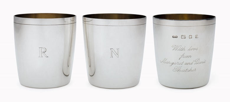 A pair of Elizabeth II silver beakers, a personal gift from Margaret and Denis Thatcher to President and Mrs. Ronald Reagan. Mark of Adrian Gerald Benney, London, 1985 and 1990. Each with gilt interior, inscribed 'With love from Margaret and Denis Thatcher' to one side, the reverse each with an initial R or N, marked on rim and to base. Estimate $1,000-2,000. This lot will be offered