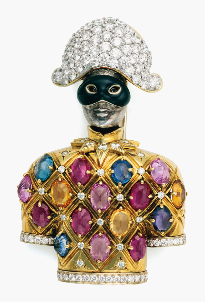 A multi-gem, diamond and gold harlequin brooch by Nardi, Venezia, circa 1980. The yellow gold figure with inset multi-gem dress, diamond hat and enamelled eye-covering, with gold double pin for brooch and two loops for pendant suspension, signed Nardi Venezia. 2⅝ in (6.6 cm) long. Estimate $12,000-18,000. This lot is offered in Living with Art, 26-27 July at Christie's in New York