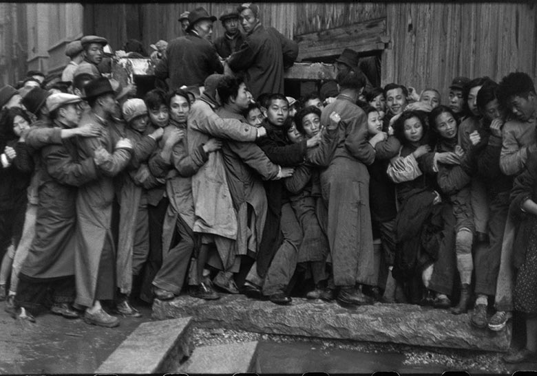 Henri Cartier-Bresson's photograph of a queue at a bank in Shanghai during the currency crisis of December 1948 © Henri Cartier-BressonMagnum Photos