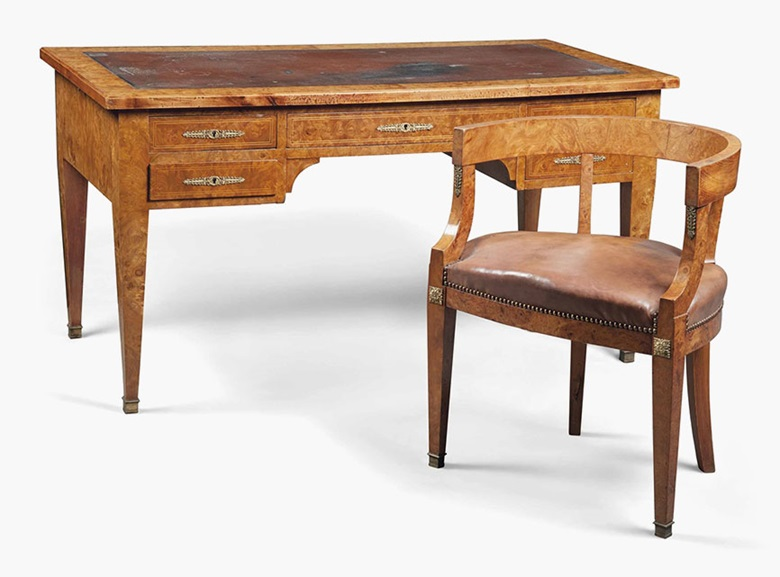 A French burr-elm desk and matching chair. Empire style, late 19thearly 20th century. Desk 29½ in (75 cm) high; 57½ in (146 cm) wide; 29½ in (75 cm) deep; chair 29 in (74 cm) high; 23½ in (60 cm) wide