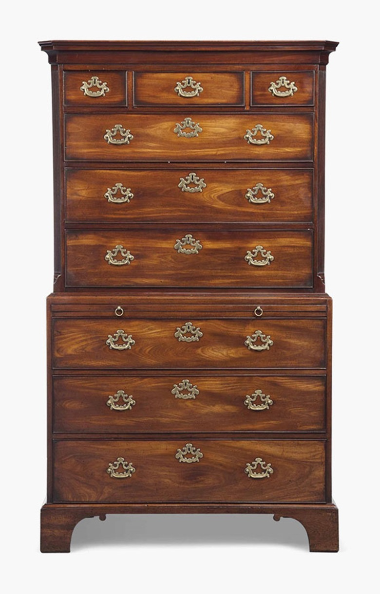 A George III figured mahogany tallboy. Late 18th century. 73 in (185 cm) high; 42½ in (108 cm) wide; 22 in (56 cm) deep. Sold for £4,375 on 20 July 2016