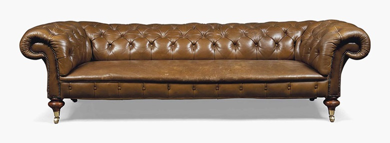 A late Victorian brown leather Chesterfield sofa. Late 19th century. 27 in (68.5 cm) high; 93 in (236.5 cm) wide; 39½ in (105 cm) deep. Sold for £3,250 on 20 July 2016