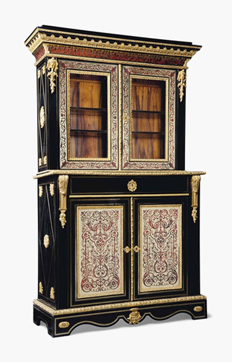 A Napoleon III ormolu-mounted, cut-brass and red tortoiseshell-inlaid, ebony boulle marquetry side cabinet. Third quarter 19th century. 82 in (208 cm) high; 52¾ in (134 cm) wide; 20½ in (52 cm) deep. Sold for £3,750 on 20 July 2016