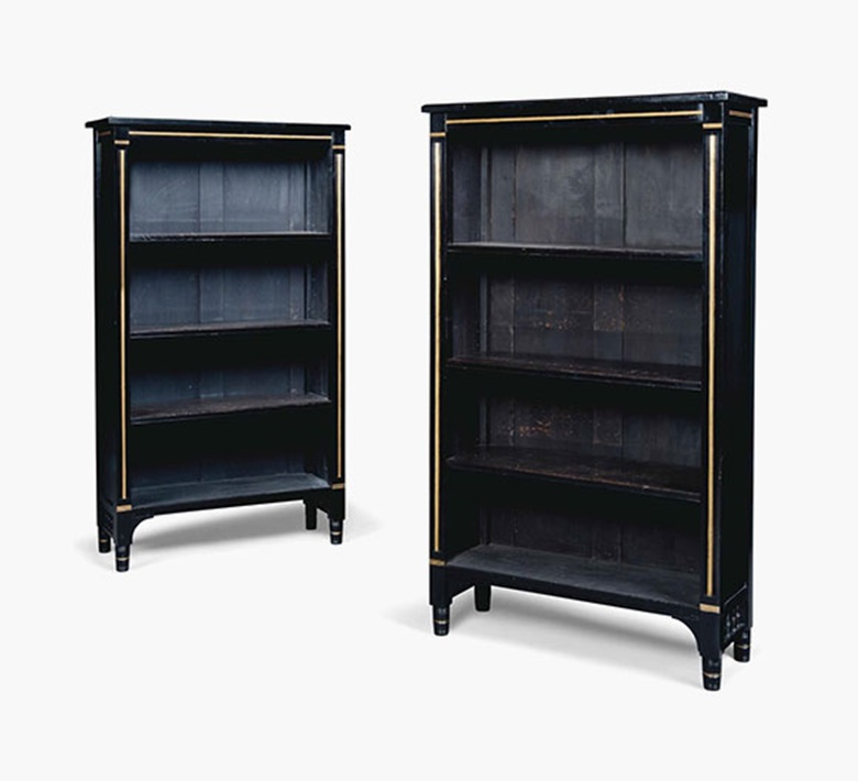 A pair of ebonised and gilt-heightened open bookcases. Late 19th century. Each 58½ in (148.5 cm) high; 33½ in (85 cm) wide; 13¼ in (33.5 cm) deep. Sold for £3,000 on 20 July 2016