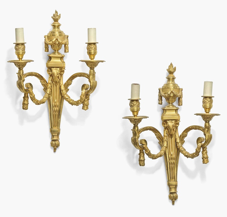 A pair of ormolu twin-branch wall appliques. Of Louis XVI style, after a model by Jean-Charles Delafosse, late 19th century. 19½ in (50 cm) high. Sold for £2,500 on 20 July 2016 at Christie's in London