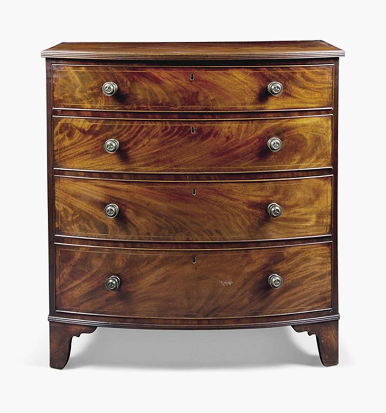 A Regency mahogany bowfront chest. Early 19th century. 41¼ in (105 cm) high; 38⅜ in (97.5 cm) wide; 23¾ in (60.5 cm) deep. This lot was offered in Interiors on 20 July 2016 at Christie's in London, South Kensington