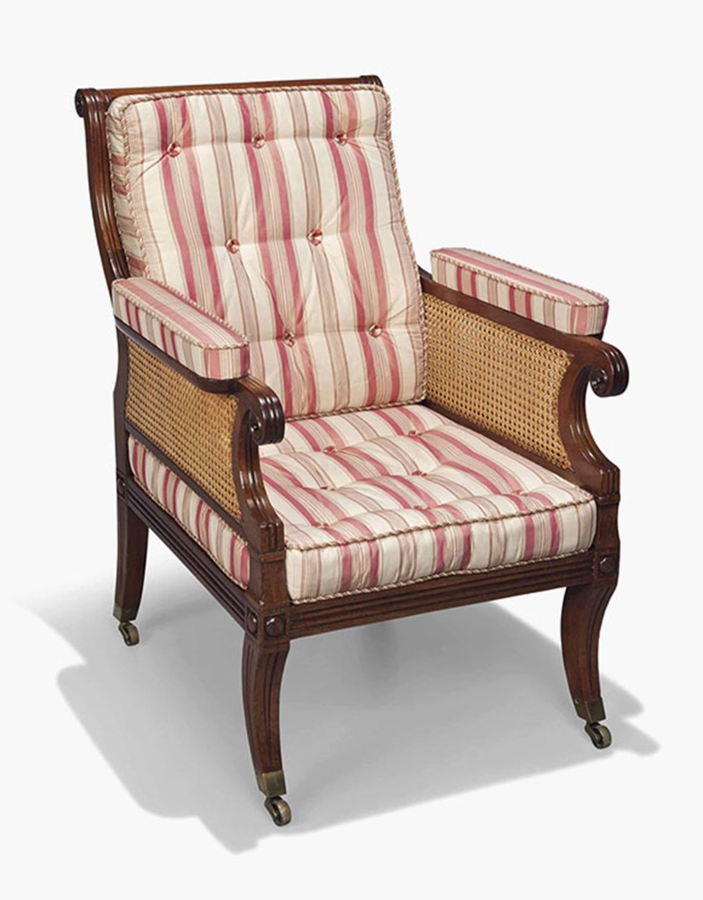 A Regency mahogany caned bergère. First quarter 19th century. 38½ in (98 cm) high; 27¾ in (70.5 cm) wide; 33 in (84 cm) deep