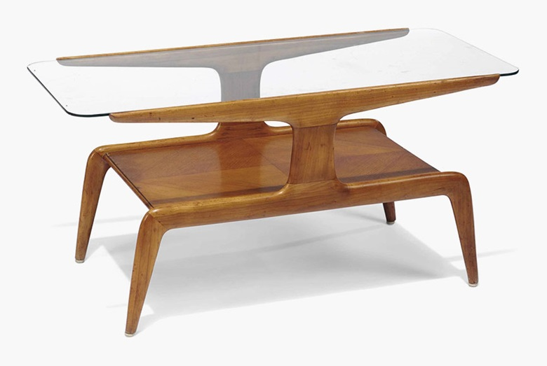 A stained and veneered beech two-tier occasional table in the style of Gio Ponti. Third quarter 20th century. 18½ in (47 cm) high; 37¾ in (96 cm) wide; 17¾ in (45 cm) deep