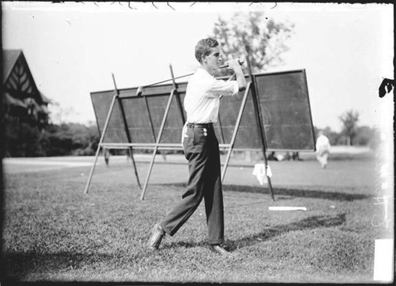 A young Robert E. Hunter demonstrates the swing that helped win him an Olympic gold medal